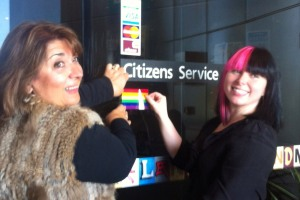 Cr Stella Kariofyllidis and I attach the rainbow flag to the Coburg Civic Centre for IDAHO